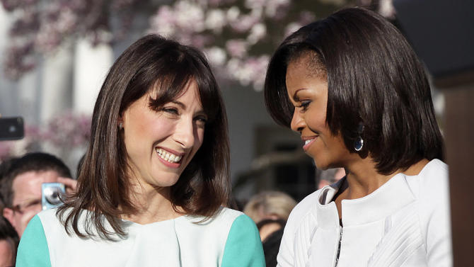 Samantha Cameron, wife of British Prime Minister David Cameron talks with first lady Michelle Obama during an official arrival ceremony on the South Lawn of the White House in Washington Wednesday, March 14, 2012. (AP Photo/Carolyn Kaster)