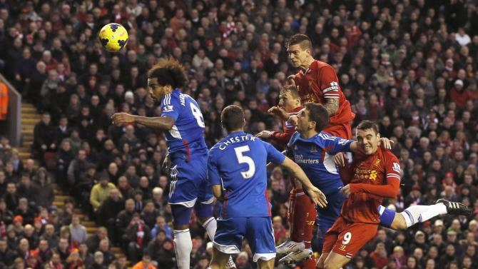Liverpool's Agger scores a goal against Hull City during their English Premier League soccer match at Anfield in Liverpool