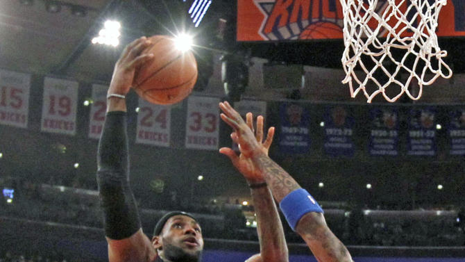 Miami Heat's LeBron James (6) goes to the basket against New York Knicks' J.R. Smith (8) during the first half of an NBA basketball game Saturday, Feb. 1, 2014, in New York. (AP Photo/Jason DeCrow)