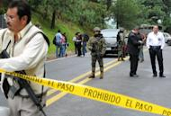 Forensic personnel inspect a US diplomatic vehicle on the Tres Marias-Huitzilac highway in Morelos, Mexico, August 24. Mexican federal police shot at the US diplomatic car as they chased criminals south of Mexico City, in a chaotic incident that left two US embassy employees wounded