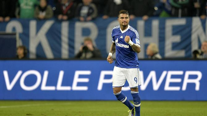 Schalke's Kevin-Prince Boateng makes a fist after scoring twice during the German Bundesliga soccer match between FC Schalke 04 and Werder Bremen in Gelsenkirchen, Germany, Saturday, Nov. 9, 2013