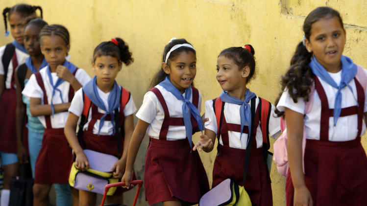 School girls line up for the start of classes in Santiago de Cuba, Cuba, Monday, Nov. 5, 2012. Classes resumed Monday in a sign of some return to normalcy after the passing of Hurricane Sandy, but more than 100 schools remain shuttered due to storm damage. (AP Photo/Ismael Francisco, Cubadebate)