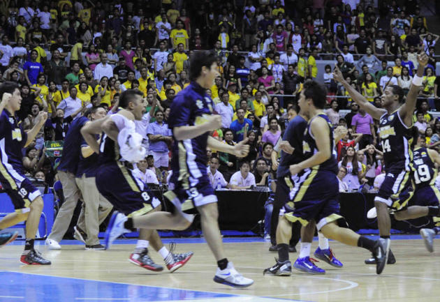 The NU Bulldogs whoop it up after beating the FEU Tamaraws and clinching a Final Four slot. (NPPA Images)