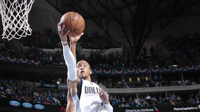 Ellis, Barea keep Mavs alive with 121-109 win over Rockets