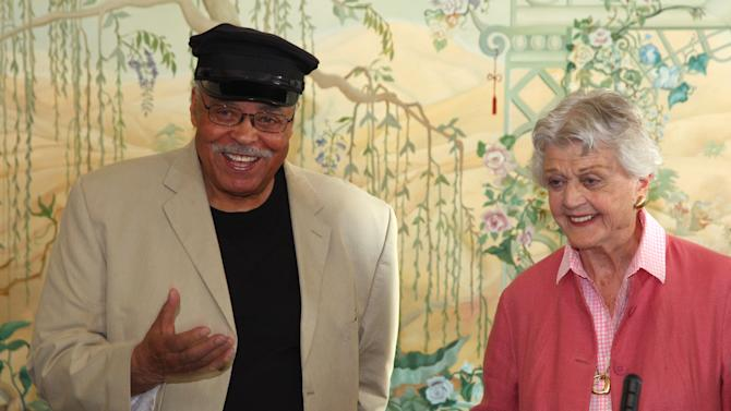 """Actors James Earl Jones, left, and Angela Lansbury discuss their rolls in the play """"Driving Miss Daisy"""" in Sydney, Australia, Monday, Jan. 7, 2013. Jones and Lansbury, in Australia to star in a touring production of Alfred Uhry's Pulitzer-Prize winning play """"Driving Miss Daisy,"""" credit the thrill of performing with their seemingly endless supply of energy, which has propelled them throughout their decades-long careers. (AP Photo/Rick Rycroft)"""