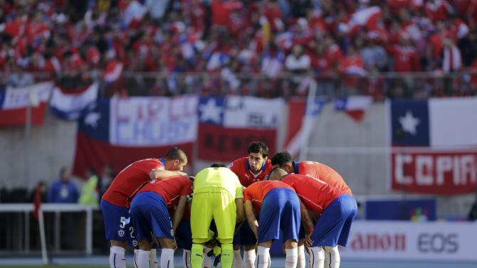 The Chile squad huddle before their Copa America 2015 final soccer match against Argentina at the National Stadium in Santiago