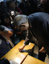 Egyptian reform leader and Nobel Peace Prize laureate Mohamed ElBaradei casts his vote at a polling station in Giza, Egypt Thursday, Dec. 15, 2011. Islamists and liberals made accusations of abuses during the second round of Egypt's first post-Hosni Mubarak parliamentary elections as voters cast ballots Thursday in mostly rural parts of the country. (AP Photo/Nasser Nasser)