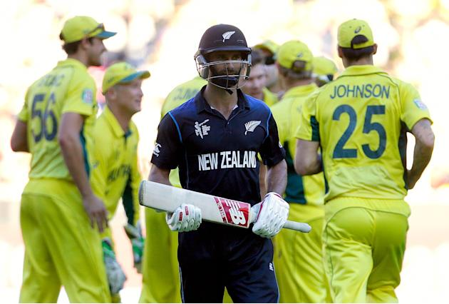 New Zealand's Grant Elliott walks off the field after being dismissed for 83 runs during the Cricket World Cup final match against Australia at the MCG