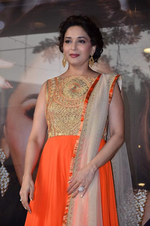 Madhuri Dixit Nene during the prize distribution ceremony of Kshan Ala Bhagyachya by P N Gadgil Jewellers in Mumbai on November 15, 2013. (Photo: IANS)