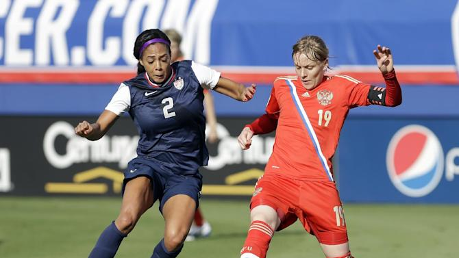 United States' Sydney Leroux, left, and Russia's Ksenia Tsybutovich (19) battle for the ball during an  international friendly soccer match in Boca Raton, Fla., Saturday, Feb. 8, 2014. The U.S. won 7-0