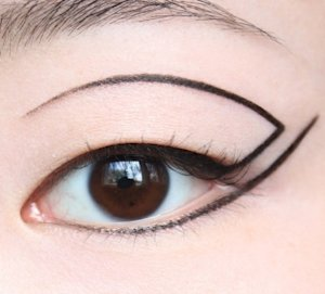 A modern and interesting liquid eyeliner look