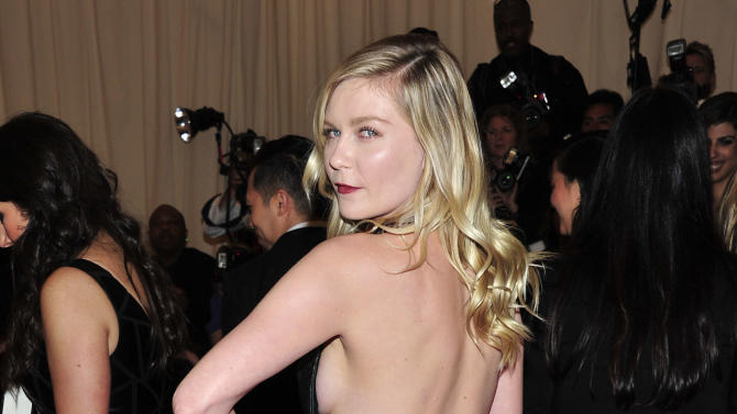 "Kirsten Dunst attends The Metropolitan Museum of Art's Costume Institute benefit celebrating ""PUNK: Chaos to Couture"" on Monday, May 6, 2013, in New York. (Photo by Charles Sykes/Invision/AP)"