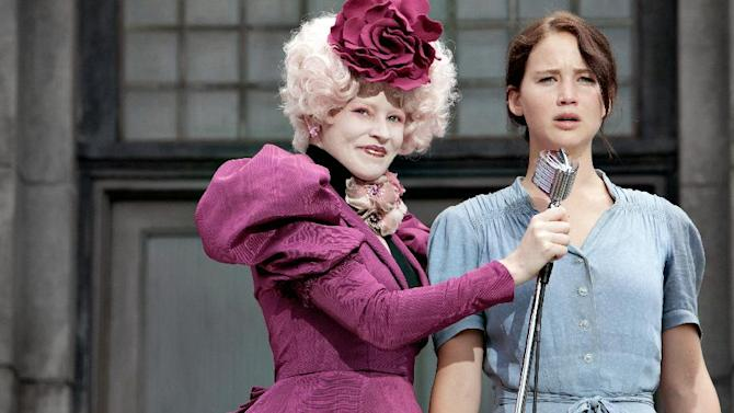 Still from 'The Hunger Games,' Effie Trinket (Elizabeth Banks, left) and Katniss Everdeen (Jennifer Lawrence).
