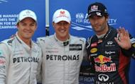 Mercedes' driver Michael Schumacher (centre) is flanked by his teammate Nico Rosberg (left) and Red Bull's Mark Webber after the qualifying session for the Monaco Grand Prix. Schumacher rolled back the years with the fastest lap in qualifying for Sunday's race, although Webber will start the race from pole position