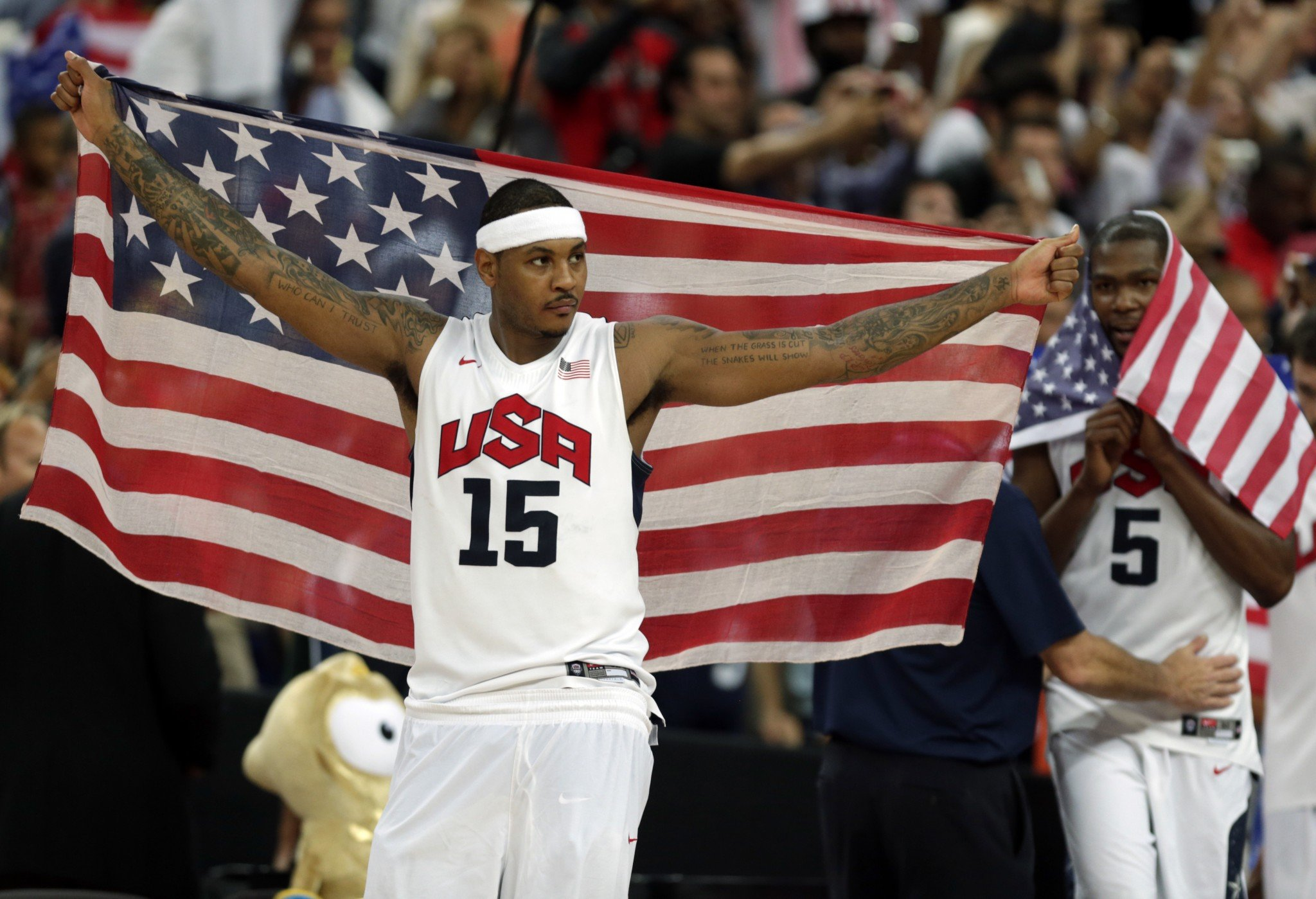 Carmelo Anthony of the United States celebrates after the men's gold medal basketball game at the 2012 Summer Olympics. (AP/Charles Krupa, File)