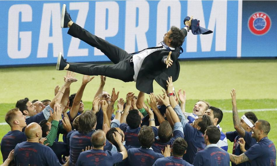 SOC: Barcelona players and coach Luis Enrique celebrate after winning Champions League final