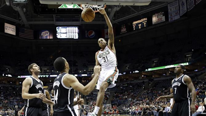 Milwaukee Bucks' John Henson dunks during the second half of an NBA basketball game against the Brooklyn Nets Saturday, Dec. 7, 2013, in Milwaukee