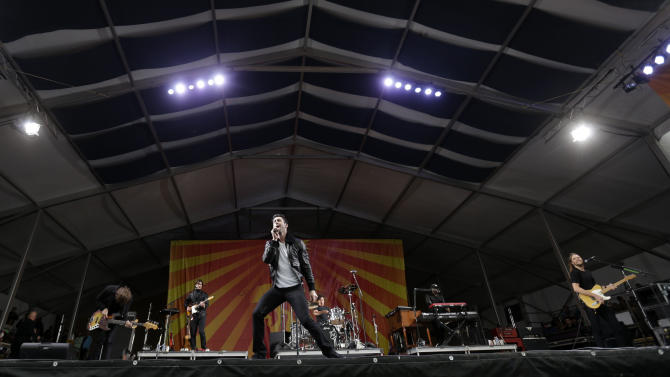 Maroon 5 at the New Orleans Jazz and Heritage Festival in New Orleans, Friday, May 3, 2013. (AP Photo/Gerald Herbert)