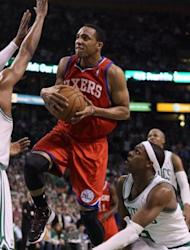 Philadelphia 76ers' Evan Turner (L) heads for the net as Boston Celtics' Rajon Rondo (R) defends during game two of the NBA Eastern Conference series on May 14. Philadelphia won 82-81
