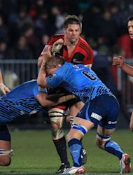 Richie McCaw (top), captain of the Canterbury Crusaders, is tackled by Northern Bulls' Flip van der Merwe and Dewald Potgieter during their Super 15 match on July 21. The Crusaders raced to a 16-0 lead before the Bulls were on the board