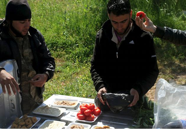 Free Syrian Army fighters prepare food in the al-Arbaeen mountain area of western Idlib