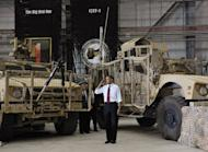 US President Barack Obama salutes as he arrives to address troops during a visit to Bagram Air Field in Afghanistan. Obama signed a US-Afghanistan strategic partnership agreement during his unannounced visit to the country