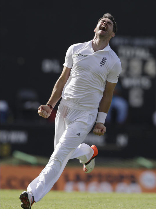 England's James Anderson celebrates taking the wicket of West Indies' Denesh Ramdin on the last day of their first cricket Test match at the Sir Vivian Richards Cricket Ground in Antigua, Anti