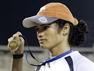A female Indian athlete who won a gold medal at the 2006 Asian Games appeared in court on Friday charged with raping her former lover who has alleged that she is actually a man. Pinki Pramanik (seen here in a file photo) was remanded in custody for 14 days to await trial on allegations that she repeatedly raped her female live-in partner