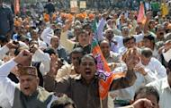 Supporters of the opposition Bharatiya Janata Party (BJP) shout anti-UPA government slogans during a rally to protest against Foreign Direct Investment (FDI) prior to the Winter Session of Parliament in New Delhi. India's parliament adjourned in uproar on the first day of what promises to be a stormy new session for the weakened government and its pro-market reform drive