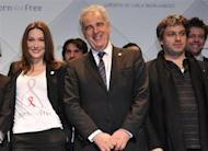 France's then First lady Carla Bruni-Sarkozy (L), professor Michel Kazatchkine (C), Executive Director of the Global Fund to Fight AIDS, Tuberculosis and Malaria, and Julien Civange (R), musician and adviser of Carla Bruni-Sarkozy, attend the International launch of the Born Hiv Free campaign in Paris May 19, 2010. REUTERS/Philippe Wojazer/Files
