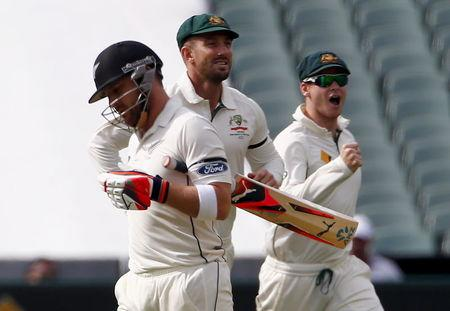 Australia's captain Steve Smith and team mate Shaun Marsh celebrate after New Zealand's captain Brendon McCullum was dismissed for four runs during the first day of the third cricket test matc