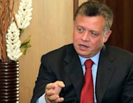 A picture from the Jordanian Royal Palace shows King Abdullah II speaking during an interview with AFP in Amman on Wednesday. The king accused Israel of disrupting Jordan's nuclear energy plans and warned of sectarian violence spilling across the border from Syria