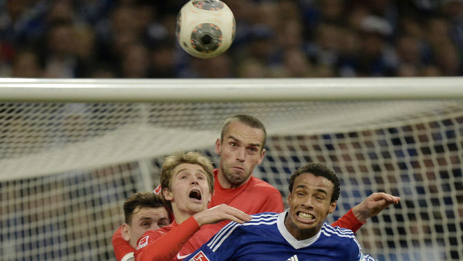 Schalke's Joel Matip jumps in front of Freiburg's defense for the ball during the German Bundesliga soccer match between FC Schalke 04 and SC Freiburg in Gelsenkirchen, Germany, Sunday, Dec. 15, 2013