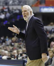 San Antonio Spurs head coach Gregg Popovich questions a call during the first half of an NBA basketball game against the Indiana Pacers, Monday, Feb. 13, 2017, in Indianapolis. (AP Photo/Darron Cummings)