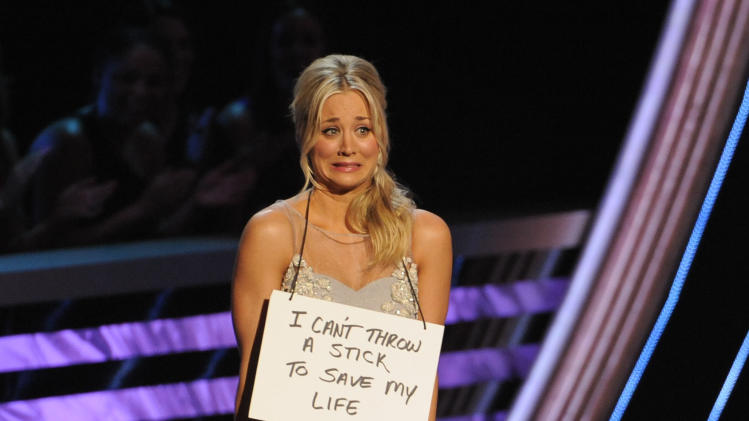 Host Kaley Cuoco is seen on stage at the People's Choice Awards at the Nokia Theatre on Wednesday Jan. 9, 2013, in Los Angeles. (Photo by Chris Pizzello/Invision/AP)