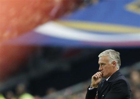 France's coach Deschamps reacts during the 2014 World Cup qualifying soccer match against Finland at the Stade de France stadium in Saint-Denis