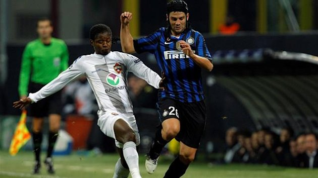 Inter Milan's Cristian Chivu (R) fights for the ball with CSKA Moscow's Sekou Oliseh during their Champions League Group B soccer match at the San Siro stadium
