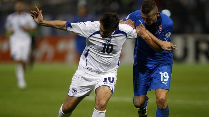 Bosnia's Misimovic fights for the ball with Slovakia's Kucka during their 2014 World Cup qualifying soccer match in Zenica
