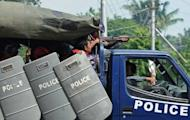 Myanmar police patrol the streets of Sittwe, the capital of the western state of Rakhine. Dozens of people have been killed in a surge in sectarian violence in Myanmar, as international pressure grew for an end to the bloodshed
