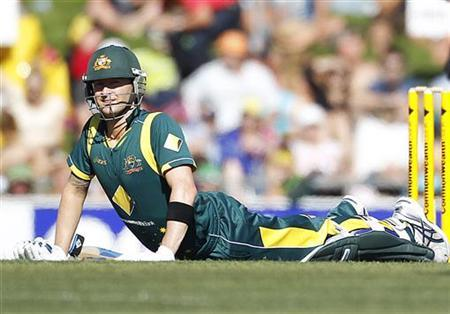 Australia's Michael Clarke stretches during their one-day international cricket match against Sri Lanka in Hobart