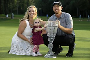 Hunter Mahan poses with his wife, Kandi, and daughter, Zoe, after winning The Barclays on Sunday. (AP)