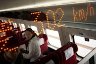 A display shows the speed aboard a train while on journey in Hebei province, south of Beijing, on December 22, 2012. China has started service on the world's longest high-speed rail route, Beijing to Guangzhou, the latest milestone in the country's rapid and -- sometimes troubled -- super fast rail network