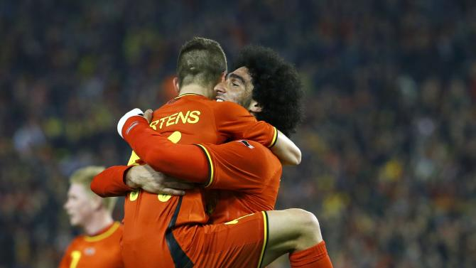 Belgium's Fellaini celebrates with team mate Mertens after scoring a goal against Ivory Coast during their international friendly soccer match at King Baudouin Stadium in Brussels