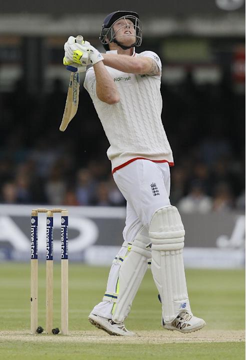 England's Ben Stokes watches as he gets a 4  off the bowling of New Zealand's Tim Southee, during the fourth day of the first Test match between England and New Zealand at Lord's cricket g