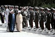 Iranian President Hassan Rowhani (L) and Oman's Sultan Qaboos bin Said (C-R) at Tehran's Saadabad Palace on August 25, 2013. The Iranian authorities have announced that Sultan Qaboos of Oman, the only Gulf leader to maintain good relations with Tehran, arrived in Iran for a focus on economic issues and diplomacy visit