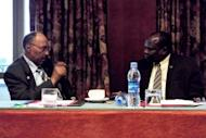Sudan's defence minister, Abdelrahim Mohamed Hussein (left) speaks with South Sudan's chief negotiator Pagan Amum during African Union-led peace talks in Addis Ababa on July 5. South Sudan set out Monday a proposed deal with rival Sudan, offering an increased oil transit fee offer, an $8.2 billion financial support package and demanding a referendum on disputed Abyei