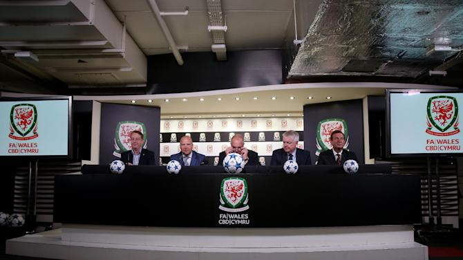 SOC: (L-R) Leader of Cardiff Council Councillor Phil Bale, Chief Executive of the FAW Jonathan Ford, President of the FAW Trefor Lloyd Hughes, First Minister of Wales Carwyn Jones AM and Group Chief Executive of Welsh Rugby Union Roger Lewis during the press conference