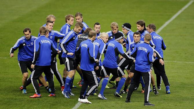 Finland's soccer team attends a training session at the Stade de France stadium in Saint Denis, north of Paris, Monday, Oct. 14, 2013, ahead of their 2014 World Cup Group I qualifying soccer match against France