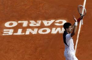 Novak Djokovic of Serbia celebrates after defeating Albert Montanes of Spain during the Monte Carlo Masters in Monaco