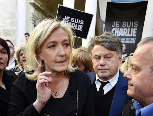Front National (FN) party president Marine Le Pen (L) and member of Parliament Gilbert Collard (R) take part in a Unity rally on January 11, 2015 in Beaucaire